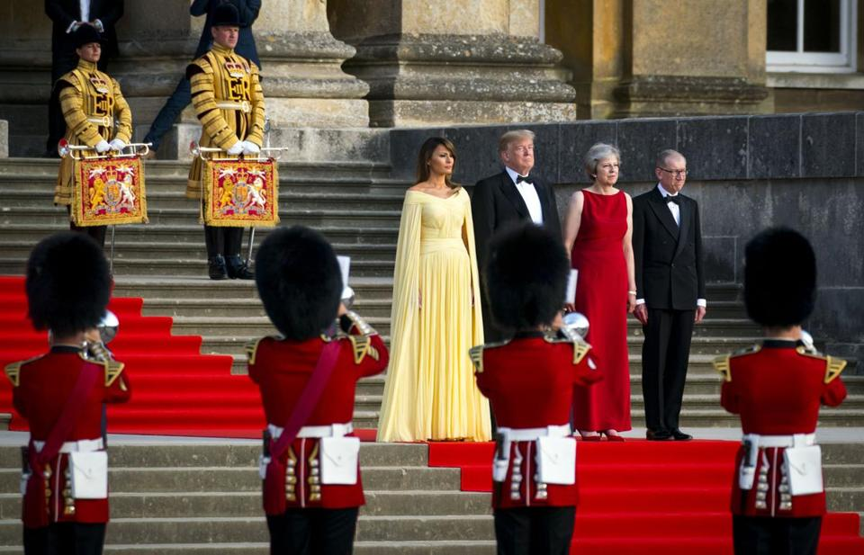 President Donald Trump, second from left, and first lady Melania Trump, left, are welcomed by British Prime Minister Theresa May and her husband, Philip May, to a gala dinner at Blenheim Palace near Oxford on Thursday, July 12, 2018. Trump is on a seven-day, three-nation European trip — to Belgium, Britain and then Finland for talks with President Vladimir Putin of Russia — that highlights the ways he has utterly transformed U.S. foreign policy. ()