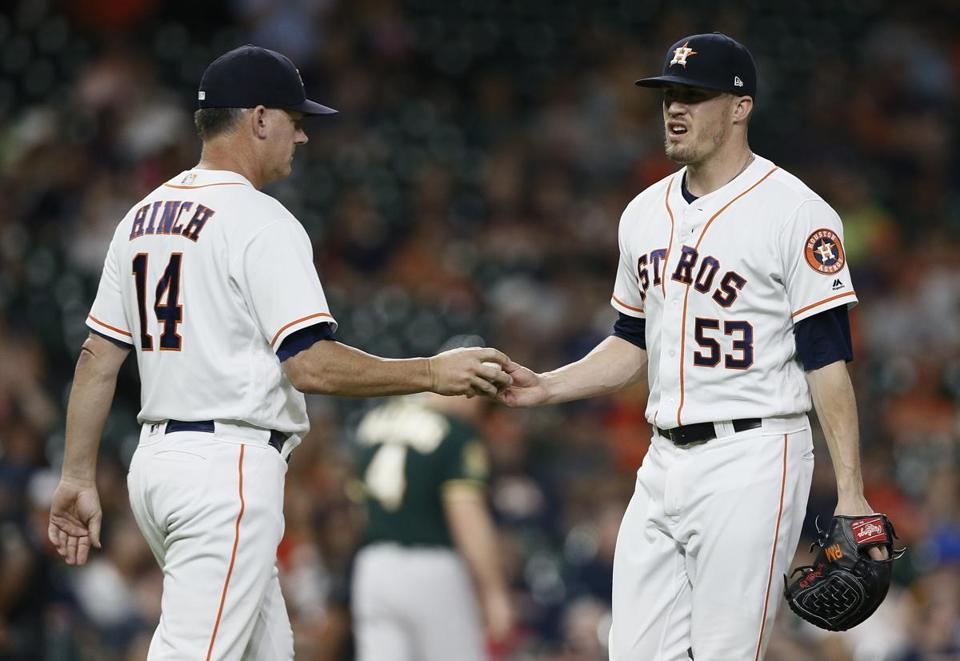 HOUSTON, TX - JULY 10: Manager AJ Hinch #14 of the Houston Astros takes the ball from Ken Giles #53 in the ninth inning against the Oakland Athletics at Minute Maid Park on July 10, 2018 in Houston, Texas. (Photo by Bob Levey/Getty Images)
