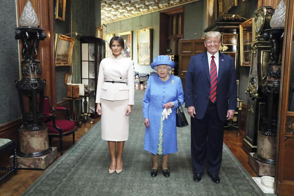 Britain's Queen Elizabeth II , centre, poses for a photo with US President Donald Trump and his wife, Melania, in the Grand Corridor during their visit to Windsor Castle, Friday July 13, 2018, in Windsor, England. (Steve Parsons/Pool Photo via AP)