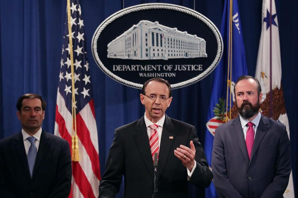 Deputy US Attorney General Rod Rosenstein and two other top Justice Department officials announced the indictment Friday.
