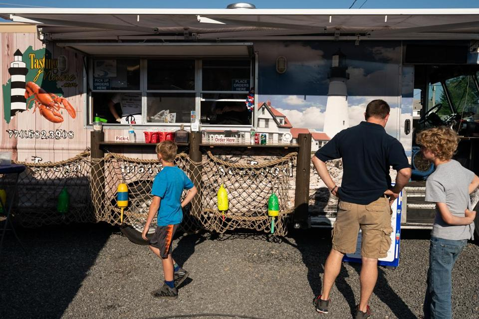 Visitors to Congdon's After Dark check out the Tasting Maine's food truck.