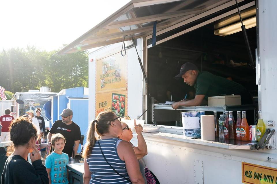 Patrons place orders at the El Rodeo Go food truck at Congdon's After Dark in Wells, Maine.