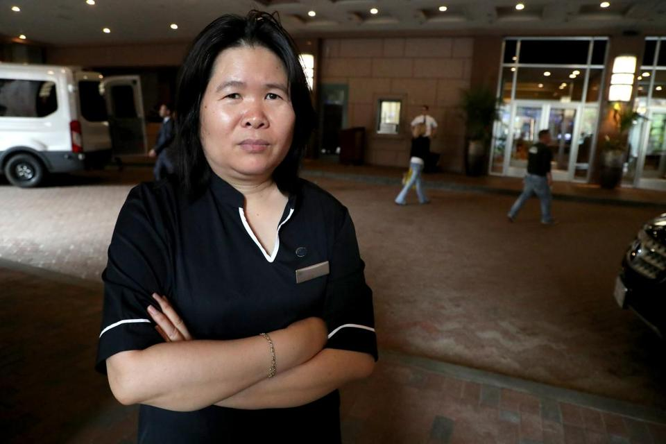 Ye Qing Wei, a housekeeper at Sheraton Boston, has seen her schedule disrupted by green programs that encourage people to opt out of housekeeping service in exchange for points and meal coupons.