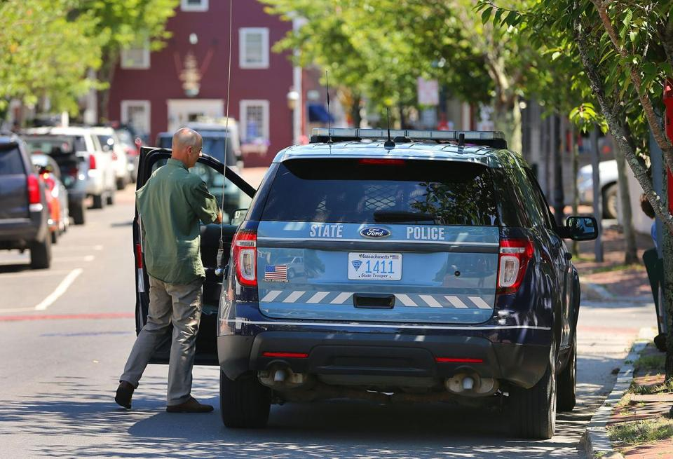 A plainclothes state trooper entered his State Police SUV on South Water Street after leaving the Nantucket District Court.