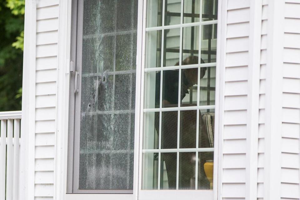 Bullet holes could be seen in the sliding glass door of a nearby home.