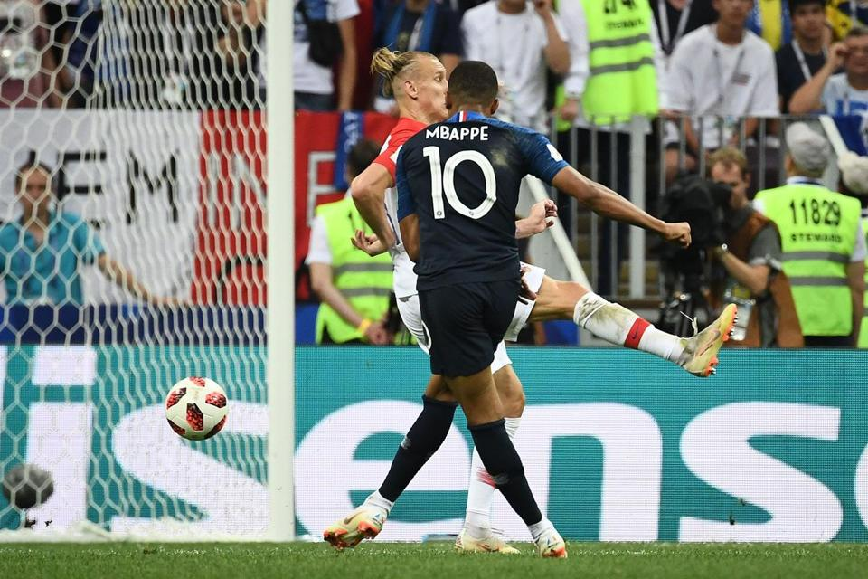 Kylian Mbappe converts to score France's fourth goal.