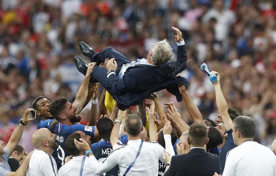 France head coach Didier Deschamps is thrown in the air at the end of the final match.