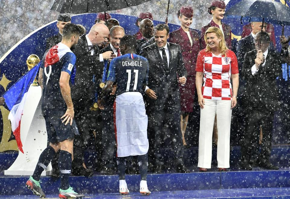 From left, FIFA President Gianni Infantino, Russian President Vladimir Putin, French President Emmanuel Macron and Croatian President Kolinda Grabar-Kitarovic congratulate the French players.