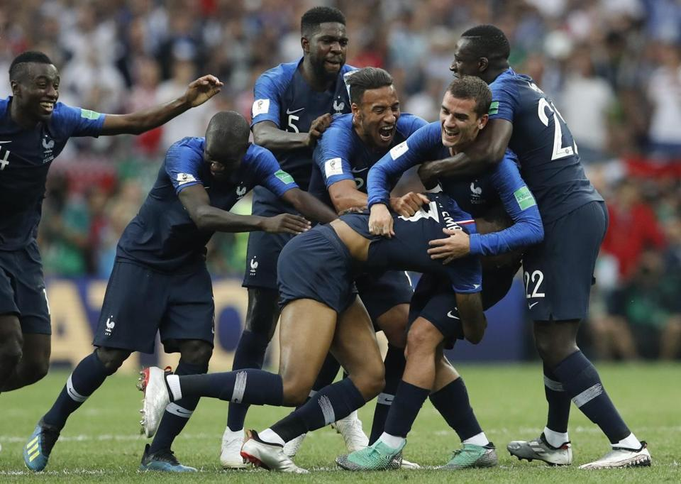 French players celebrate at the end of the final match.