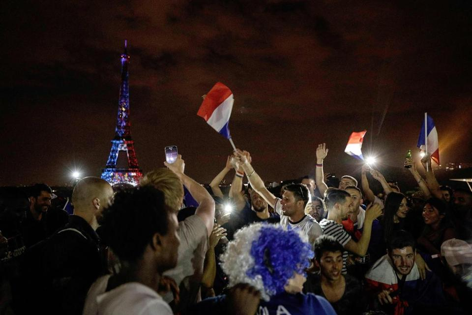 This picture taken from Trocadero on July 15, 2018 shows the Eiffel Tower illuminated in French national colors during celebrations after the Russia 2018 World Cup final football match between France and Croatia, on the Champs-Elysees avenue in Paris. / AFP PHOTO / Geoffroy VAN DER HASSELTGEOFFROY VAN DER HASSELT/AFP/Getty Images
