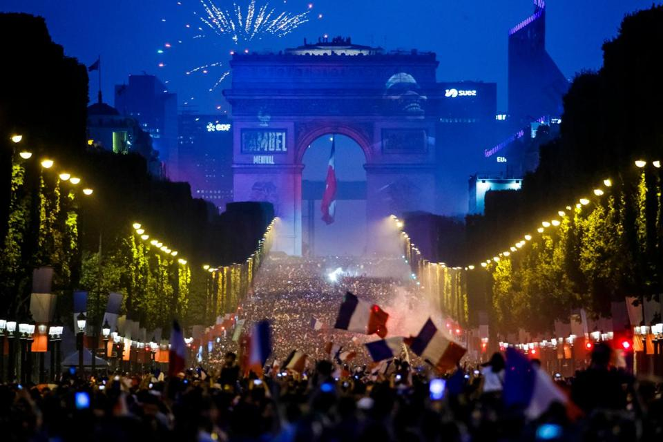 Mandatory Credit: Photo by CHRISTOPHE PETIT TESSON/EPA-EFE/REX/Shutterstock (9762108ho) French supporters celebrate on the Champs Elysees their team's victory after the FIFA World Cup 2018 final match between France and Croatia in Paris, France, 15 July 2018. France won 4-2. France feature FIFA World Cup 2018, Paris - 15 Jul 2018
