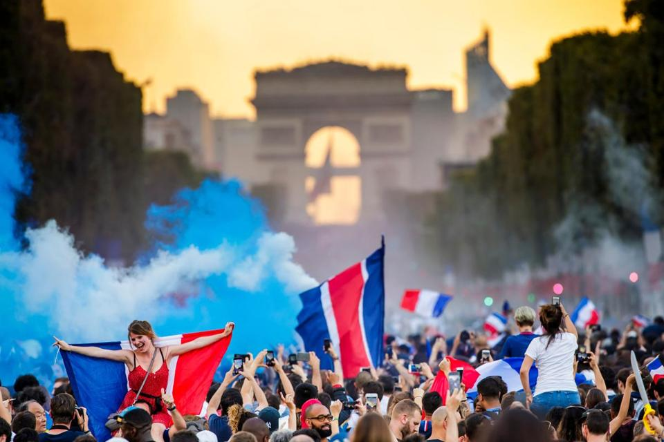 Mandatory Credit: Photo by CHRISTOPHE PETIT TESSON/EPA-EFE/REX/Shutterstock (9762108hy) French supporters celebrate on the Champs Elysees their team's victory after the FIFA World Cup 2018 final match between France and Croatia in Paris, France, 15 July 2018. France won 4-2. France feature FIFA World Cup 2018, Paris - 15 Jul 2018