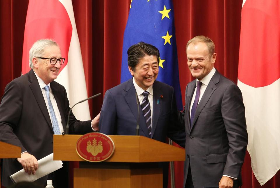(From left) European Commission President Jean-Claude Juncker, Japan's Prime Minister Shinzo Abe, and European Council President Donald Tusk at Tuesday's signing event.