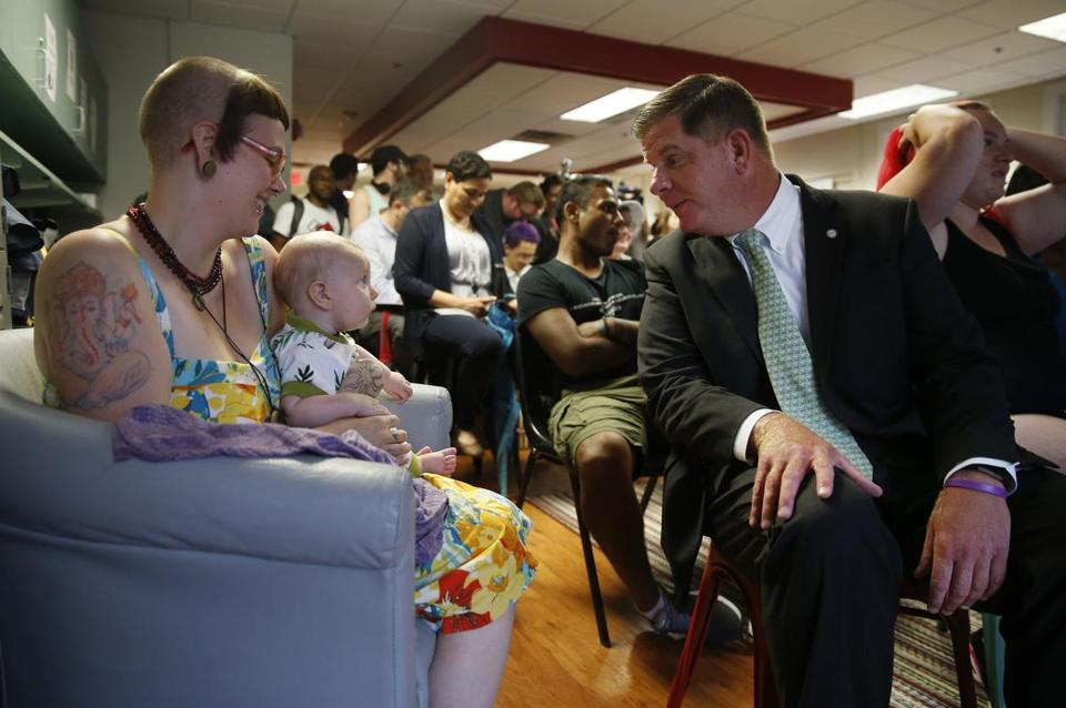 Five-month-old Atlas Arnos (center) charmed Mayor Walsh during a July 2018 event at Bridge Over Troubled Waters, which provides youth homeless services in Boston.