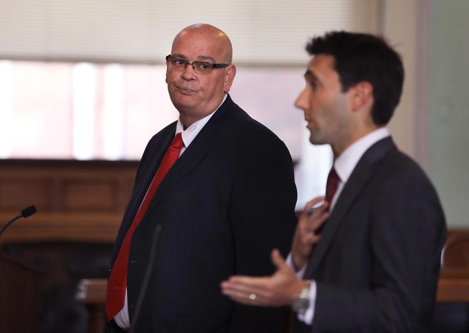 Frank Reynolds, left, appeared in Lowell Superior Court for a pre-trial hearing in July.