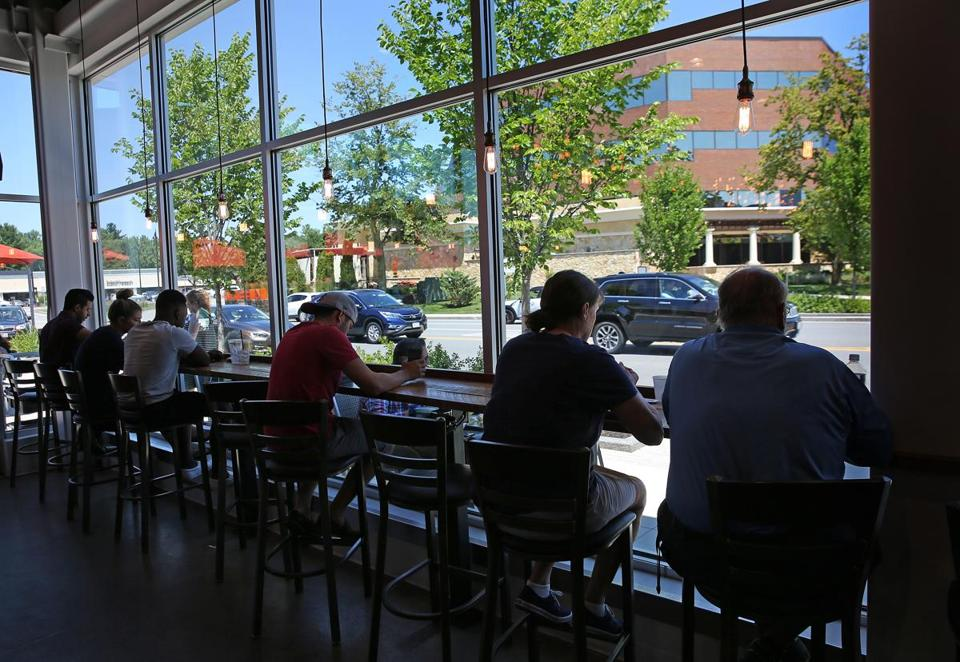 BURLINGTON, MA - 7/18/2018: Window view with bar seating at Pressed Cafe by the main road in office park. Suburban office park...The District Burlington in Burlington is an example of changes that are made to draw workers out of urban areas (David L Ryan/Globe Staff ) SECTION: BUSINESS TOPIC 28coolsuburbs