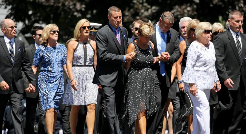 Boston, MA - July 11, 2018: Family and friends arrive for the wake for Weymouth police Sergeant Michael C. Chesna at St. Mary of the Sacred Heart Church in Hanover, MA on July 19, 2018. (Relatives and friends are invited to attend visiting hours on Thursday from 4 p.m. to 8 p.m. at St. Mary of the Sacred Heart Church in Hanover, and a funeral Mass will be held the following day at 11 a.m. in the church. Chesna, a 42-year-old, six-year veteran of the Weymouth Police Department, will be buried in Braintree's Blue Hill Cemetery. Chesna was shot with his own gun Sunday morning, according to authorities. Emanuel A. Lopes, the 20-year-old man charged with Chesna's murder and the slaying of Vera Adams, 77, was ordered held without bail Tuesday.)) (Craig F. Walker/Globe Staff) section: metro reporter: Kowalczyk St.