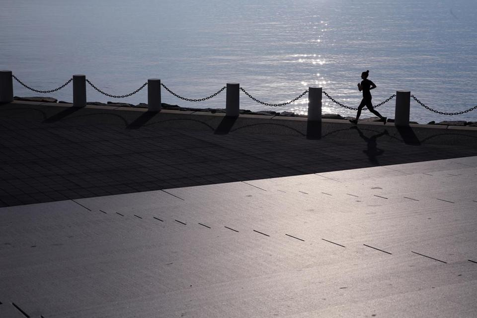 A woman ran on the Boston Harborwalk near the John F. Kennedy Presidential Library and Museum in Dorchester in May.