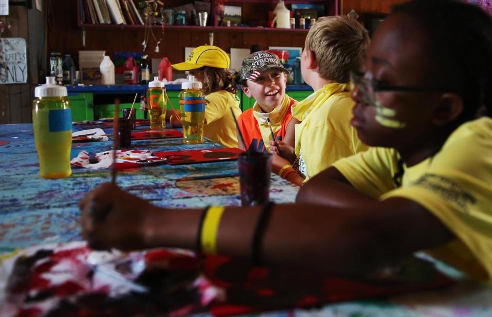 ASHFORD, CT - 07/16/2018 Geno, second from left, laughs with other campers during an arts & crafts activity at the Hole in the Wall Gang Camp. Created by Paul Newman in 1988, Hole in the Wall Gang Camp is dedicated to providing a week long camp experience to seriously ill children and their families. Erin Clark for the Boston Globe