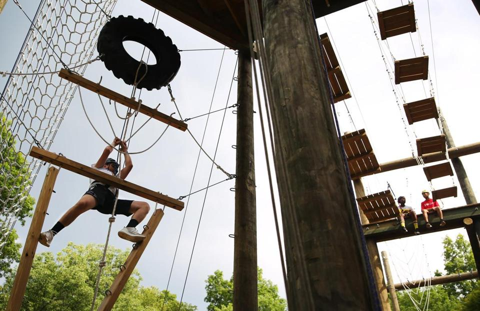 ASHFORD, CT - 07/16/2018 Nicholas, left, begins the ropes course at the Hole in the Wall Gang Camp. Created by Paul Newman in 1988, Hole in the Wall Gang Camp is dedicated to providing a week long camp experience to seriously ill children and their families. Erin Clark for the Boston Globe