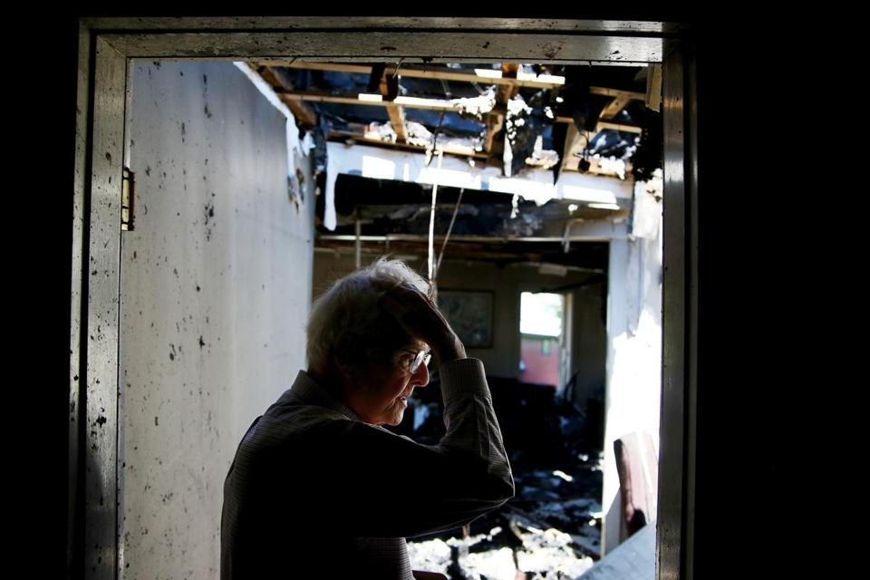 Phillip Camp, owner of the Vermont Standard, surveyed the damage at the newspaper's office, which was devastated by fire on Monday.