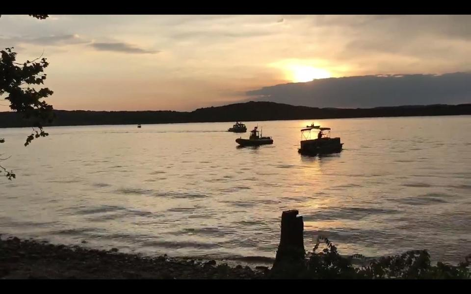 Crews working at the scene where a tourist boat capsized and sank uring a fierce storm on a lake near Branson, Missouri.