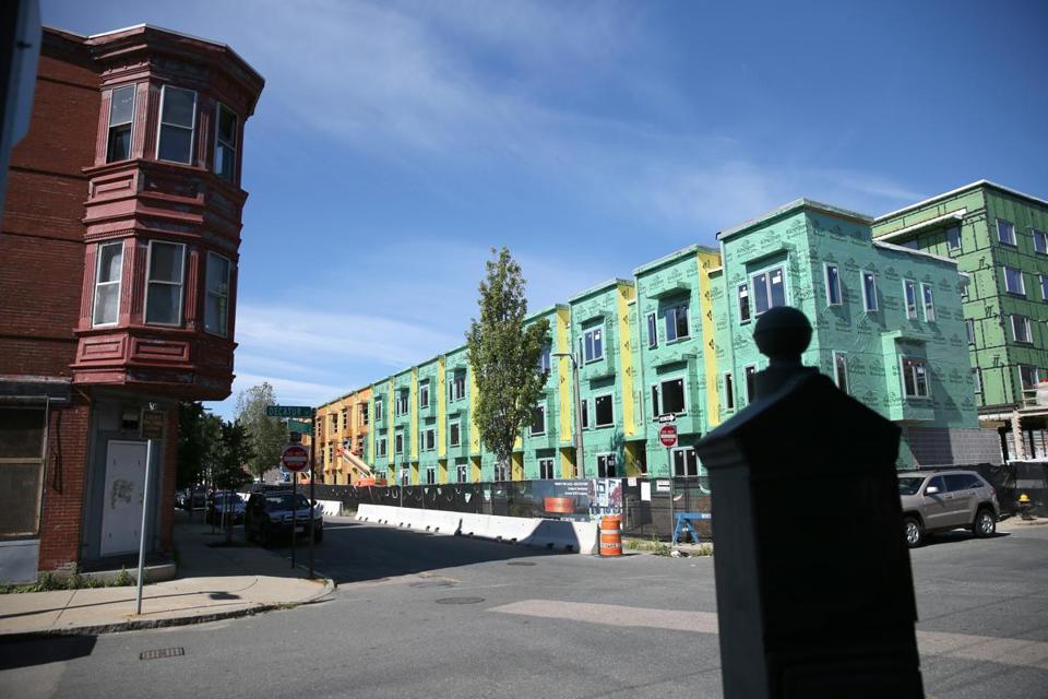 07/21/2018 East Boston Ma -East Boston is seeing growth in housing and other developments. New construction on Decatur Street and Liverpool Street in the shadow of older housing. Reporter:Topic