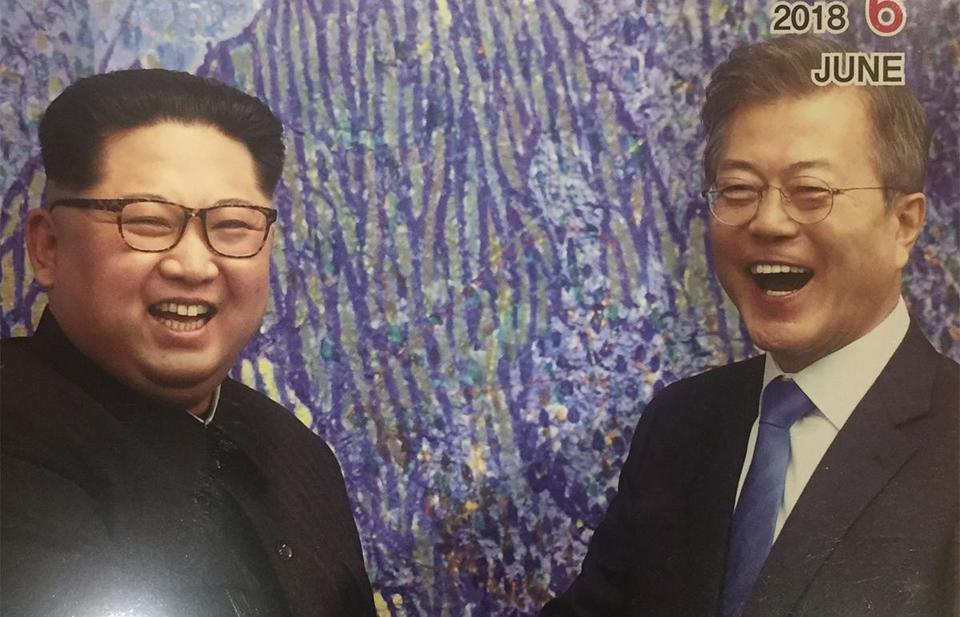 A South Korean magazine distributed in Busan shows Kim Jong Un and Moon Jae-in shaking hands on the cover.
