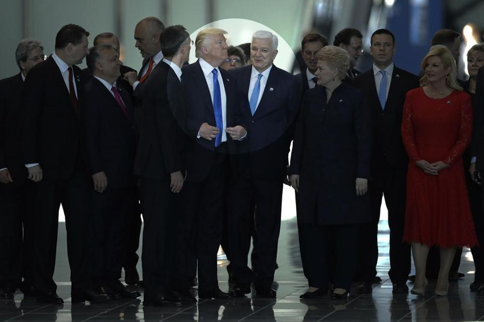 Prime Minister Dusko Markovic of Montenegro (center right) smiled after appearing to be pushed by President Trump  (center left) during a 2017 NATO summit in Brussels.