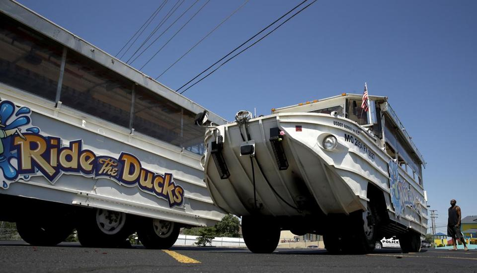 A man looks at an idled duck boat in the parking lot of Ride the Ducks Saturday, July 21, 2018 in Branson, Mo. One of the company's duck boats capsized Thursday night resulting in several deaths on Table Rock Lake. (AP Photo/Charlie Riedel)