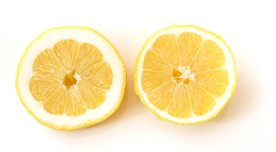 Juicier lemons and limes give a little when you squeeze them gently; if the fruit feels hard, it likely has thicker skin and less juice. Also, in my experience, fruit with a rounder shape is generally juicier than a specimen with a pronounced elliptical shape.