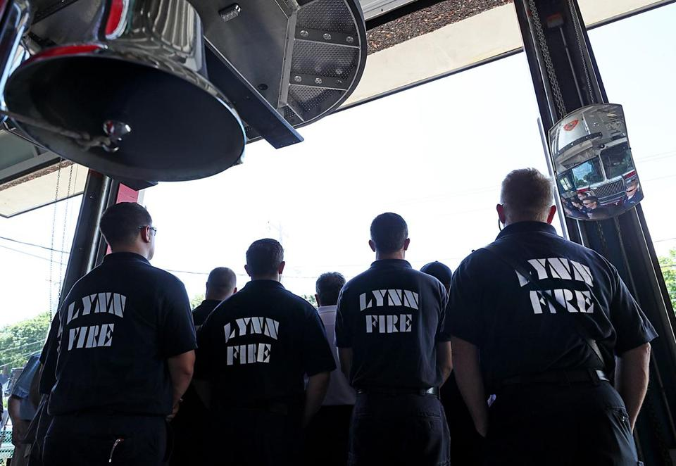 Firefighters in Lynn listened to Governor Charlie Baker at a bill signing at the Broadway Fire Station.