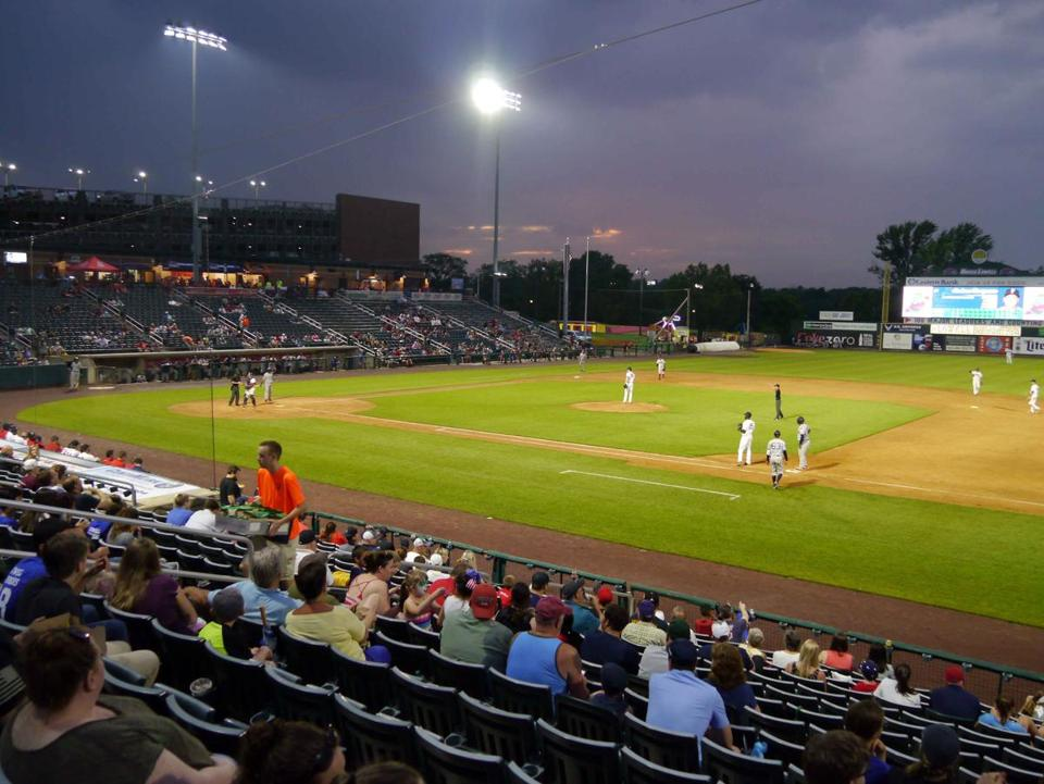 After a rain delay, the new LED lights shine brightly on Edward A. LeLacheur Park in Lowell as play gets underway in the Lowell Spinners home opener.