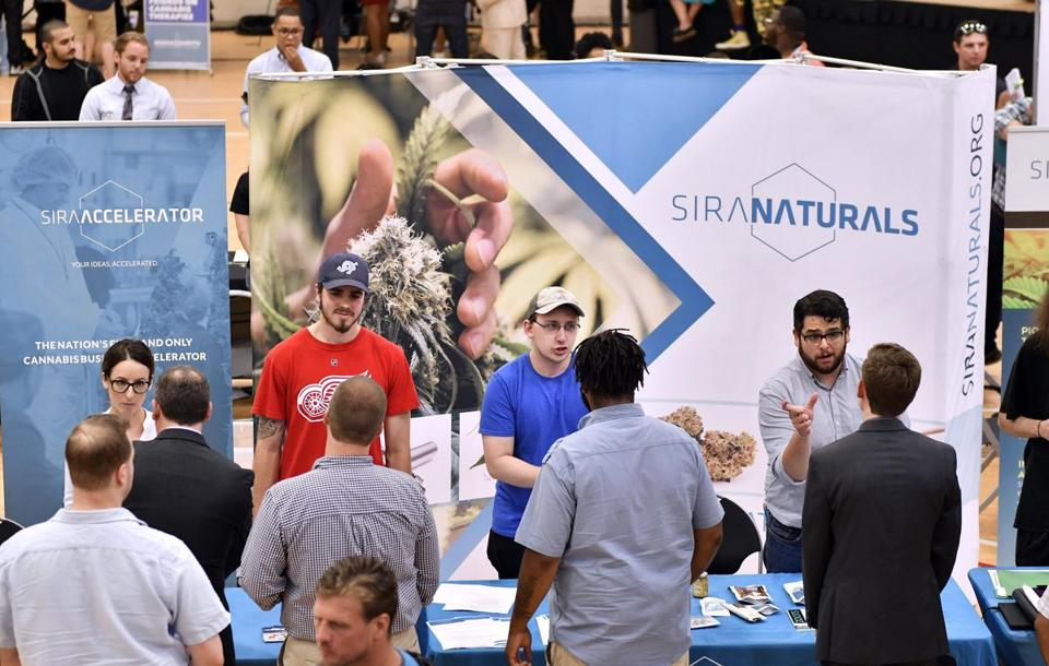 Representatives of Somerville and Cambridge-based marijuana product producer Siri Naturals spoke with prospective employees at the job fair.