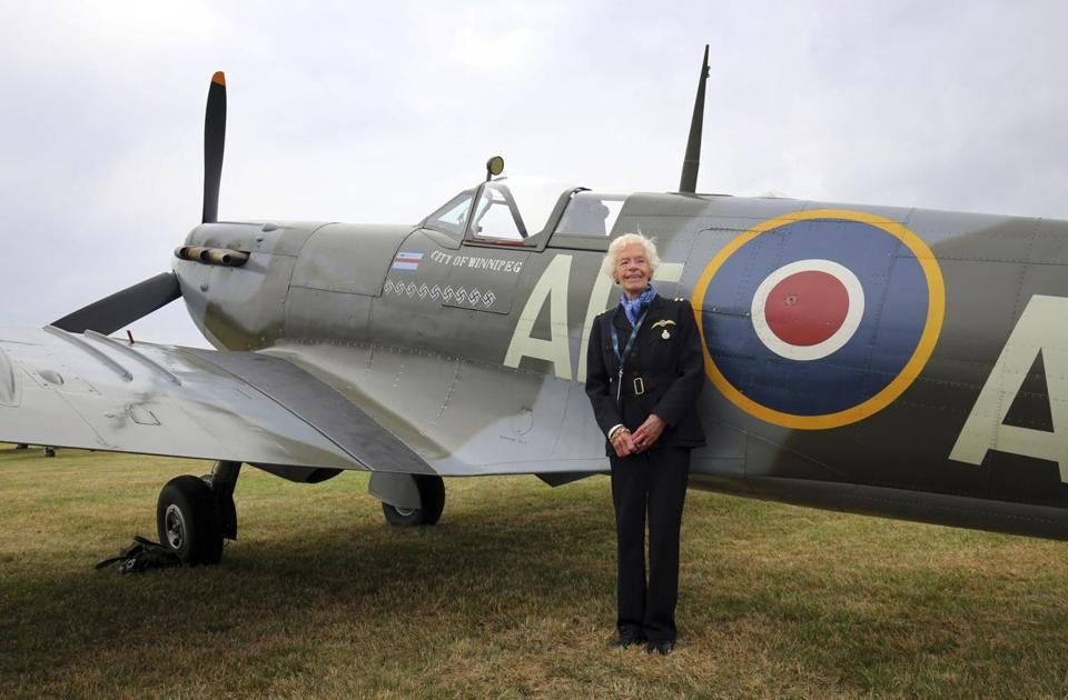 Mrs. Ellis, seen here with a Spitfire, ferried 400 Spitfires and 76 other kinds of aircraft to airfields during the war.
