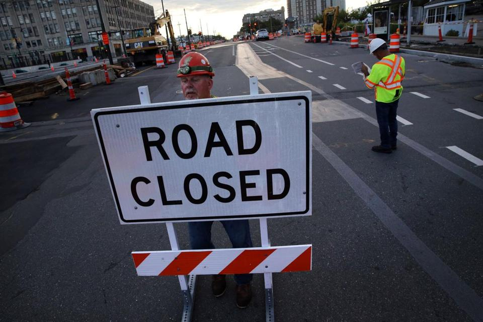 Bill Gailes of Liddell Brothers placed a road closure sign on Commonwealth Avenue last week.