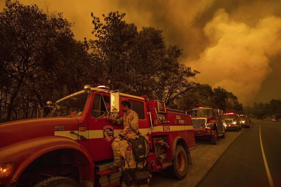Firefighters regroup while battling the Carr Fire in Shasta, Calif., on Thursday, July 26, 2018. (AP Photo/Noah Berger)
