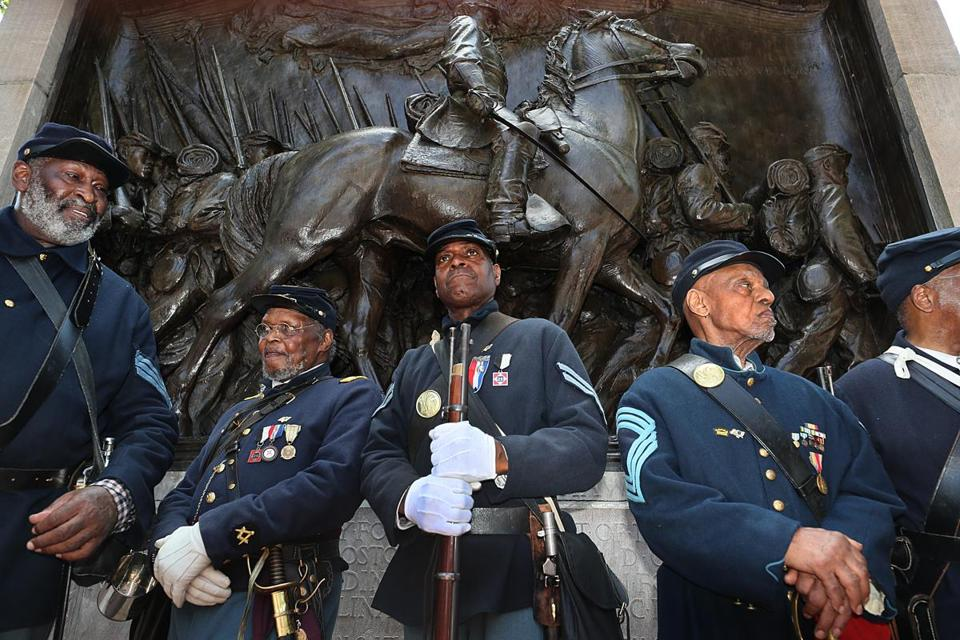 Boston, MA., 07\27\18, Massachusetts 54th Regiment reenactors posed in front of the Robert Gould Shaw and the Massachusetts 54th Regiment Memorial after an event marking a signing of a Memorandum of Understanding to jointly restore the memorial. The National Park Service, the City of Boston, Friends of the Public Garden, the Museum of African American History formed a partnership to restore the Shaw Memorial on the Boston Common across from the Massachusetts State House. A longstanding tribute to African-American soldiers who fought in the Civil War, the Robert Gould Shaw and the Massachusetts 54th Regiment Memorial is getting a restoration.