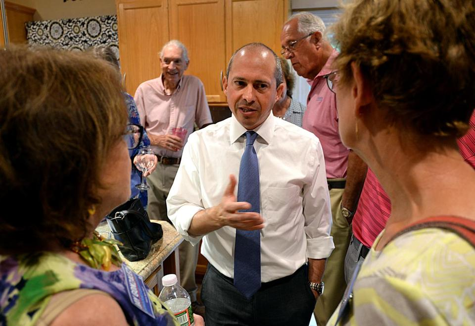 Jay Gonzalez talked to voters at a house party hosted by Tina and Jim Shinnick at their home in Walpole.