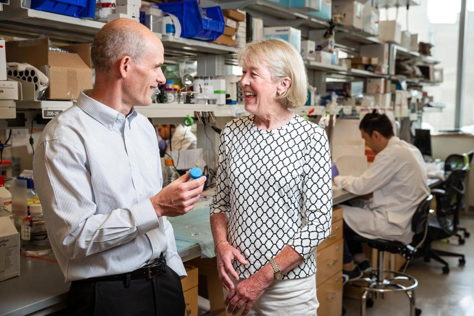 07/25/2018 BOSTON, MA Dave Mooney (cq) (left) PhD, speaks with Mary Gooding (cq) in his lab at the Wyss Institute in Boston. Mooney developed a therapeutic cancer vaccine which is implanted in patients. Gooding has received the implants during the course of her cancer treatment. (Aram Boghosian for The Boston Globe)