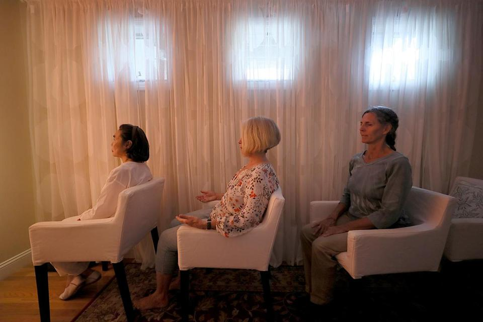 From left, Suriphan Ratanamatmongkol, Kate MacDonald, and Diane Medeiros meditated at the Inner Space Meditation Center.