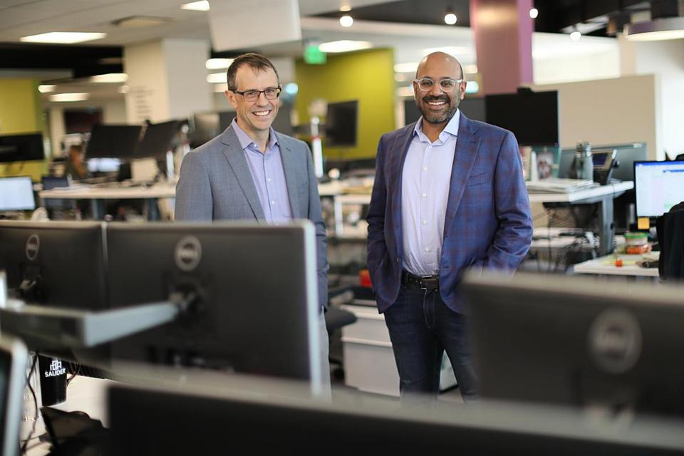 Wayfair cofounders Steve Conine (left) and Niraj Shah posed near their desks at the Internet retailer's Back Bay headquarters.