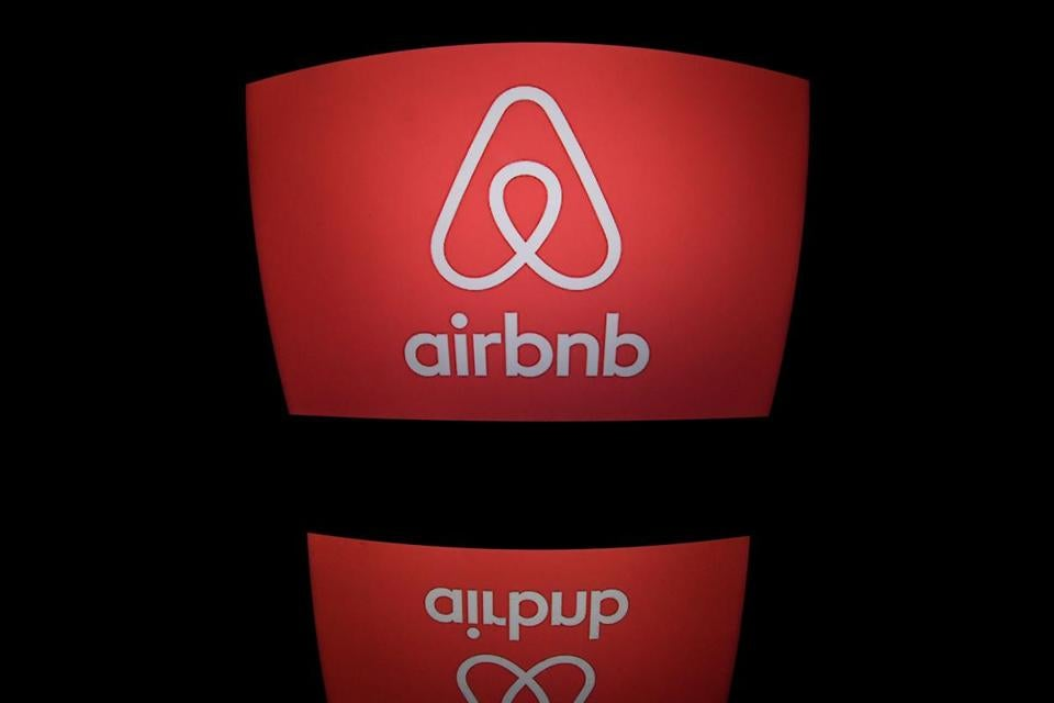 (FILES) This file photo taken on March 2, 2017 shows the logo of online lodging service Airbnb displayed on a computer screen in Paris. After the enormous success of Airbnb, which celebrates its ten years in the summer of 2018, European metropolises such as Paris, Amsterdam, Berlin and Barcelona are organising a riposte to avoid a outbreak of rents. According to an estimate made in 2017, the company worths 31 millard dollars. / AFP PHOTO / Lionel BONAVENTURELIONEL BONAVENTURE/AFP/Getty Images