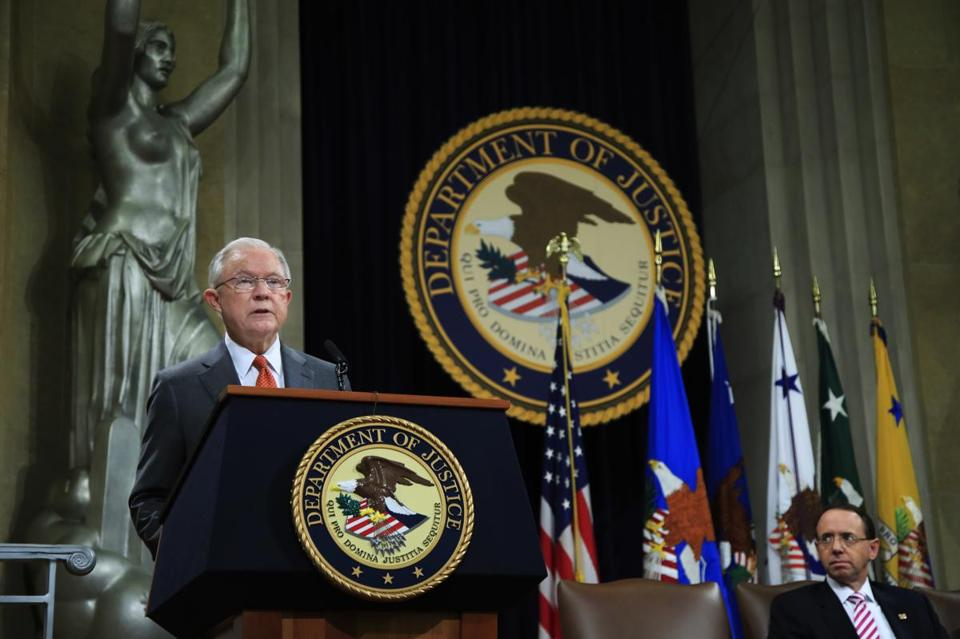 Attorney General Jeff Sessions speaks during a Religious Liberty Summit at the Department of Justice, Monday, July 30, 2018. Seated on the right is Deputy Attorney General Rod Rosenstein. (AP Photo/Manuel Balce Ceneta)