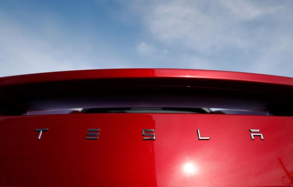 FILE - In this April 15, 2018, file photo, the sun shines off the rear deck of a roadster on a Tesla dealer's lot in the south Denver suburb of Littleton, Colo. Martin Tripp, a former Tesla Inc. employee at the electric car maker's battery plant in Nevada, is seeking at least $1 million in defamation damages after it accused him of hacking into computers and stealing confidential information leaked to the media. His lawyers filed a counterclaim in federal court in Reno, Nev., Tuesday, Aug. 2. (AP Photo/David Zalubowski, File)