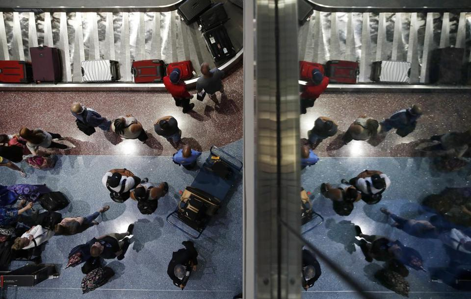 Passengers waited for baggage at McCarran International Airport in Las Vegas.