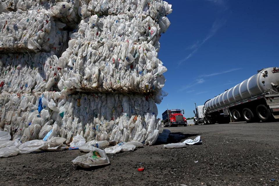 Plastic that China no longer wants stacks up at E.L. Harvey and Sons in Westborough.