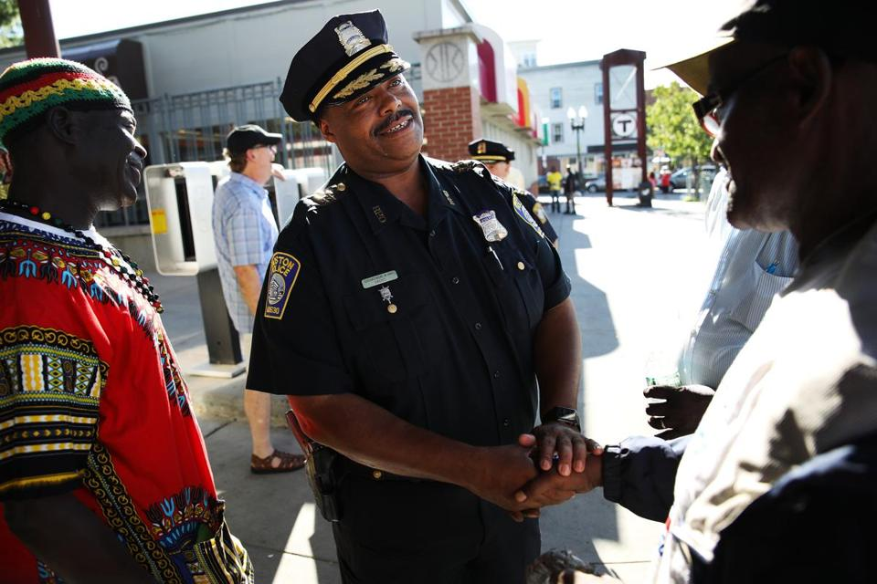 William G. Gross greeted residents during his last tour of Roxbury in uniform before being sworn in as Boston's first black police commissioner.