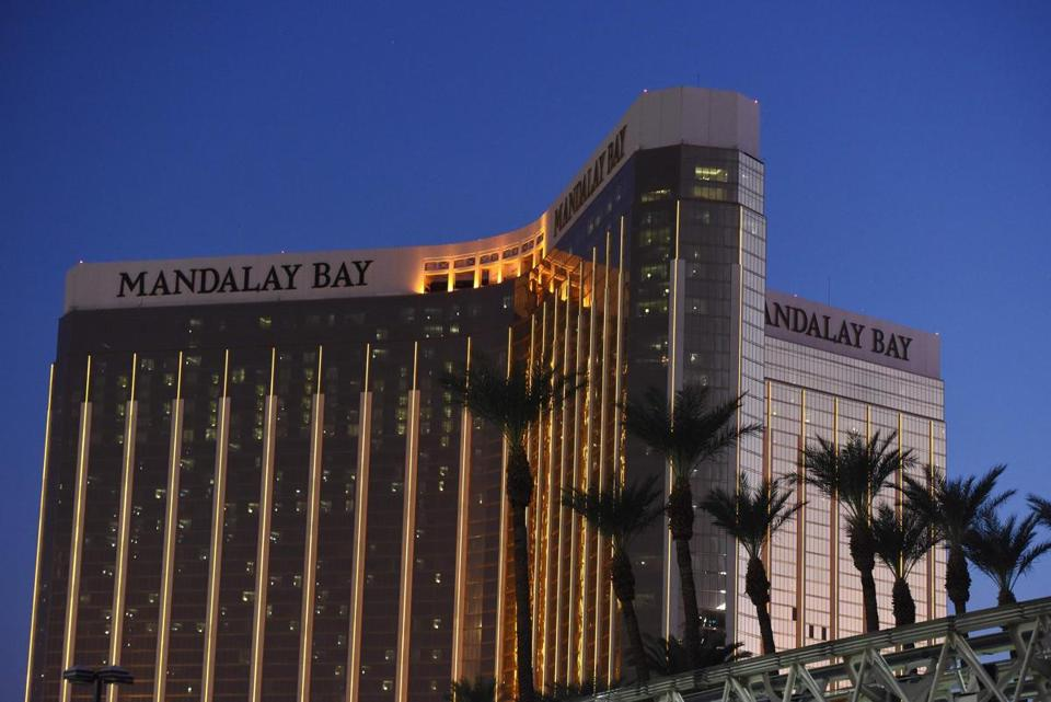 (FILES) In this file photo taken on October 04, 2017 The Mandalay Bay Hotel and Casino, that Stephen Paddock fired from 2 days later, is seen in the evening in Las Vegas, Nevada. MGM resorts sues victims of Las Vegas massacre, July 17, 2018 / AFP PHOTO / Robyn BeckROBYN BECK/AFP/Getty Images