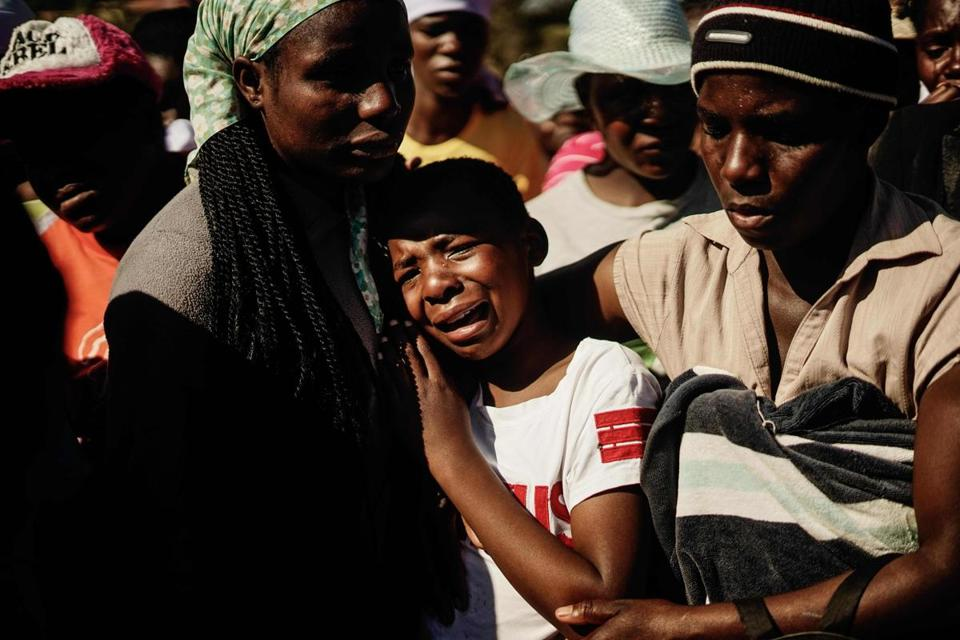 Ahlia Kumire (center) wept at her father's funeral ceremony after he was shot during post-election violence on Wednesday in Harare.